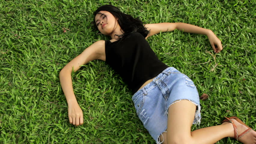 Sexy Erotic Asian Girl With Mini Skirt On Green Grass Stock Footage Video 2931934 -3227