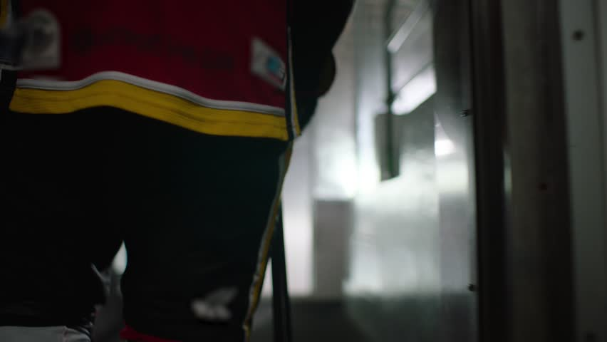 Hockey player walking towards arena and skating out onto ice.   Shutterstock Video #29327746