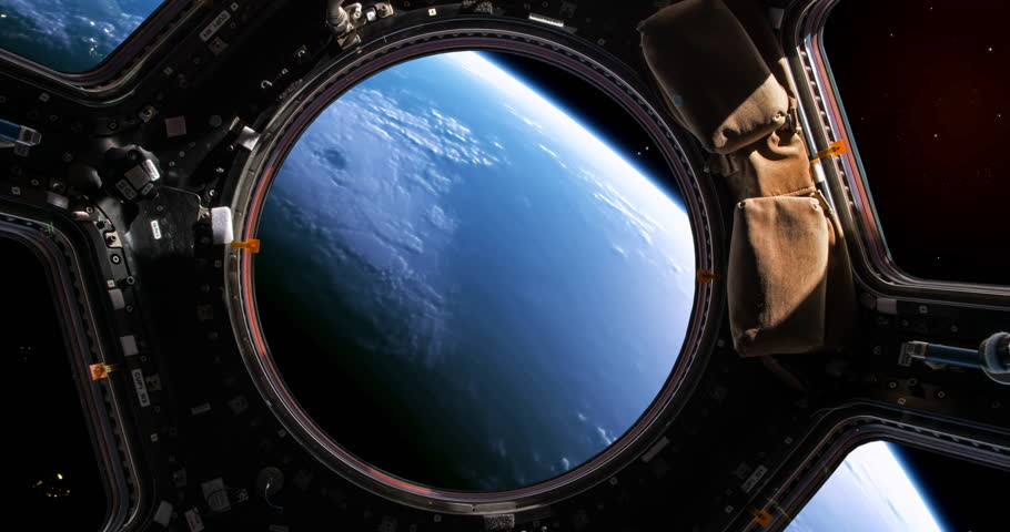 A stunning 4K view of planet earth as viewed by an astronaut who is watching it through the windows of his space shuttle.