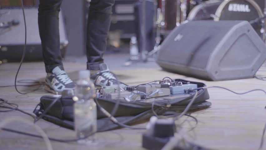 The foot of the musician presses the pedal on the stage   Shutterstock HD Video #29426317