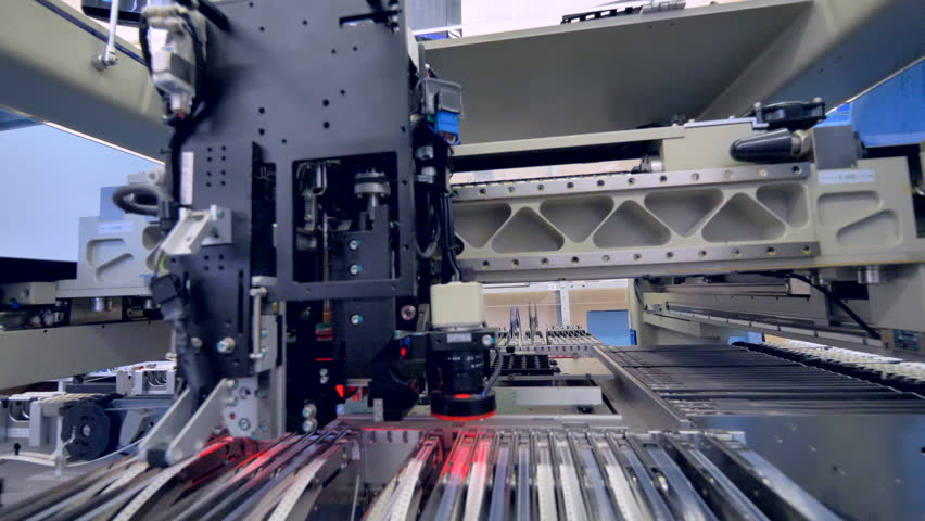 A circuit board production machine working at an electronic board plant. | Shutterstock HD Video #29620900