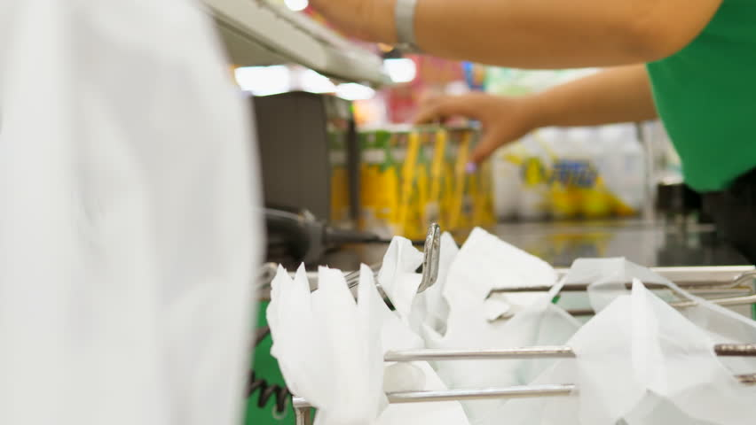 Advertise, Business Concept - Customer paying for groceries at checkout counter. Worker hands at food products cashdesk in supermarket.    Shutterstock HD Video #29739997