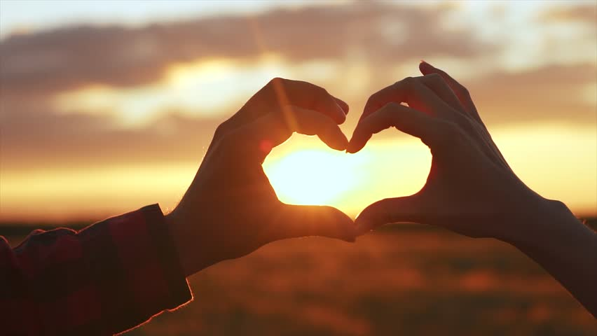 Lovers' hands in shape of love heart | Shutterstock HD Video #29751124