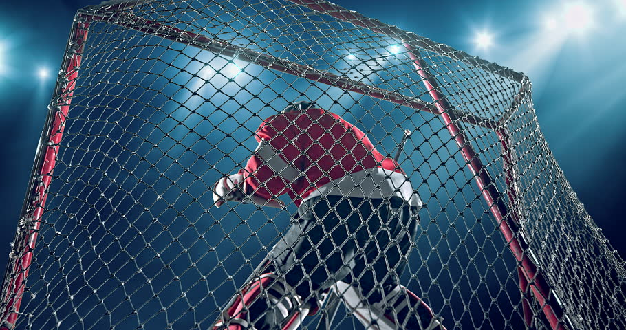 Ice Hockey goalie fails a goal on a dark background with intensional lens flares. He is wearing unbranded sports clothes.   Shutterstock Video #29841055