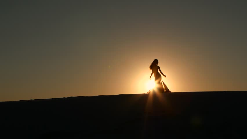 Professional dancer dances gracefully against the background of a hot sunset. Silhouette   Shutterstock HD Video #29887579