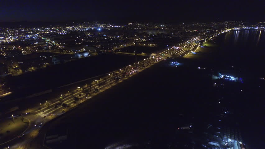 Aerial 180 pan of the nights sky in the south of the Spain part 2 of 3.  The city lights of Malaga, Spain are beautifully highlighted by the peaceful darkness of the sea. 4k 30fps august 11, 2015 | Shutterstock HD Video #29891881