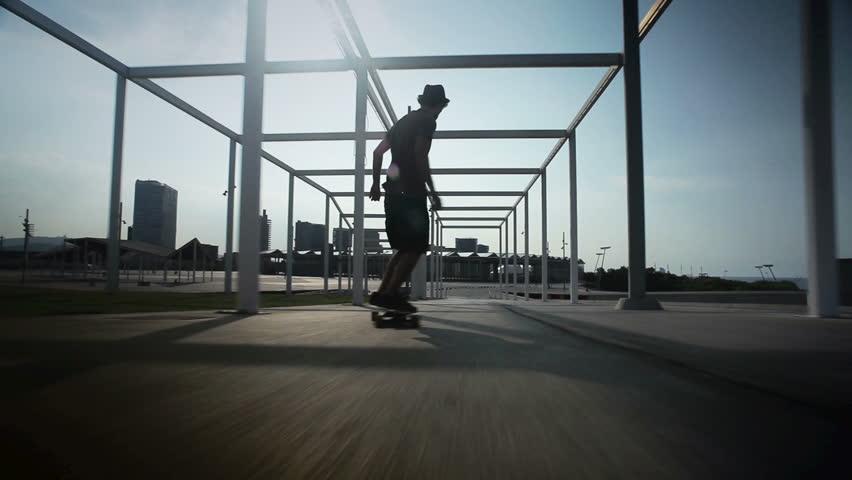 cool guy on his longboard  skate in a great park en Barcelona, Spain.  | Shutterstock Video #2992699