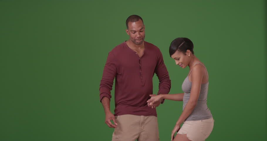 An African American couple dance on green screen. On green screen to be keyed or composited.