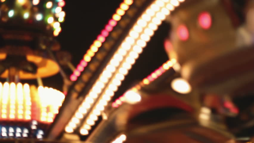 Carousels in amusement park at night