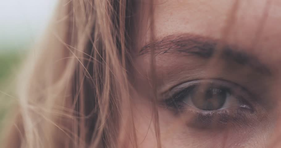 Close Up of Woman Eyes Covered with Hair Blowing on the Wind. SLOW MOTION 4K DCi. Green Eyes. Determined Female Sight. Stormy weather, autumn, winter, spring. | Shutterstock HD Video #30396652