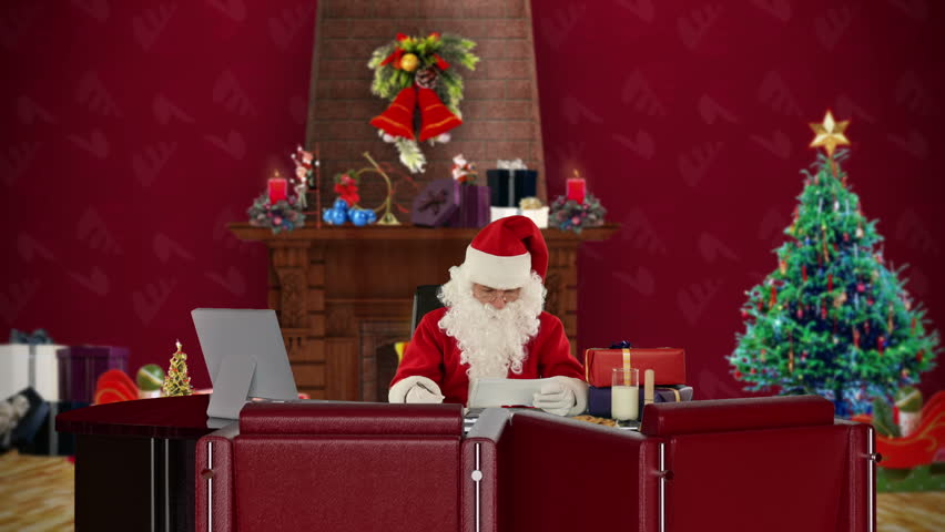 Santa Claus reading letters and sorting presents, office with Christmas