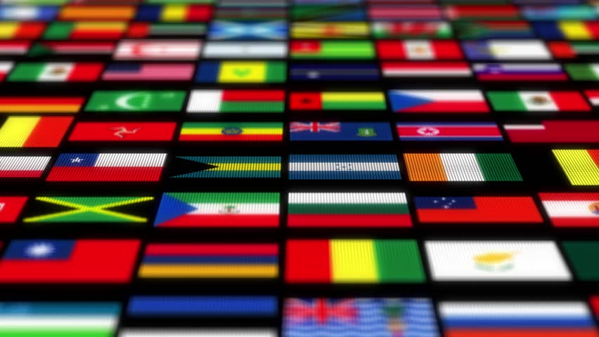 The camera flies through a flag on black background. Several flags clusters fly past, and flags of different countries can be seen in the middle. Computer animated. 3d render. Seamless loop