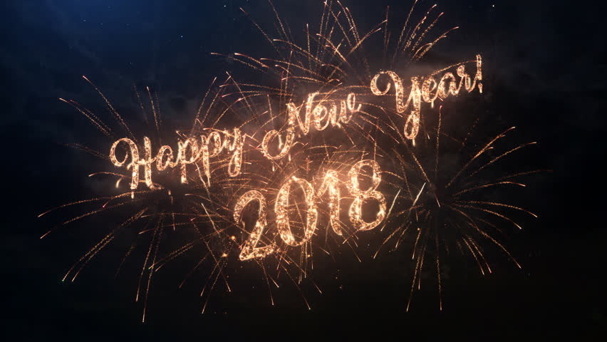 2018 Happy New Year greeting text with particles and sparks on black night sky with colored slow motion fireworks on background, beautiful typography magic design.