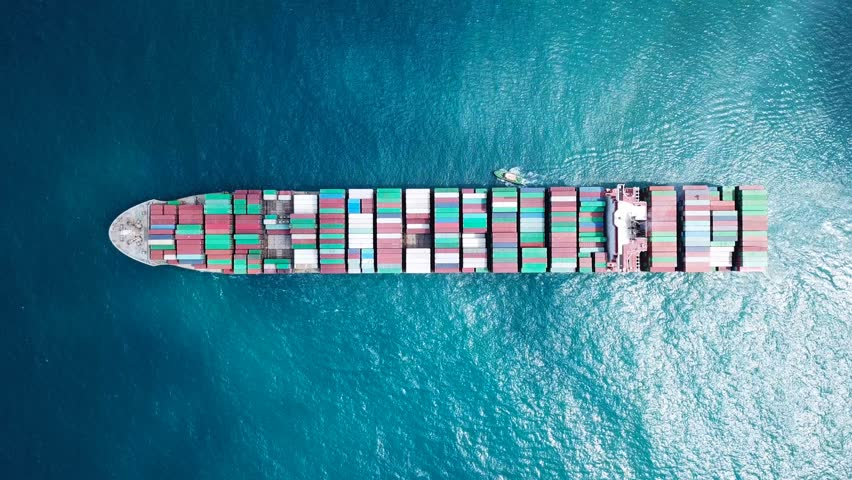 Ultra large container vessel (ULCV) at sea with a small pilot boat next to it - Aerial footage  | Shutterstock HD Video #30808684
