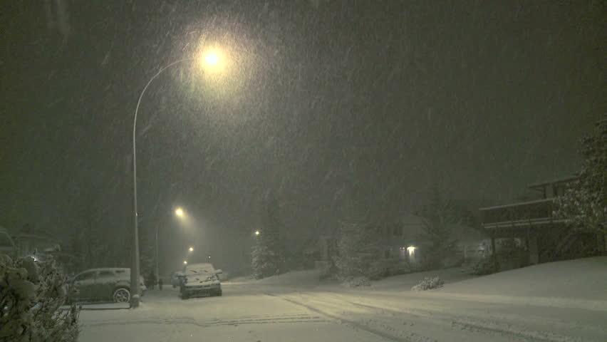 Night time snowfall in the neighborhood