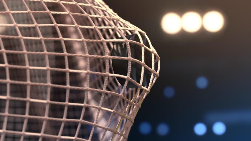 Hockey puck flies into the net. Close-up (4k, 3840x2160, ultra high definition)      Shutterstock Video #30979384