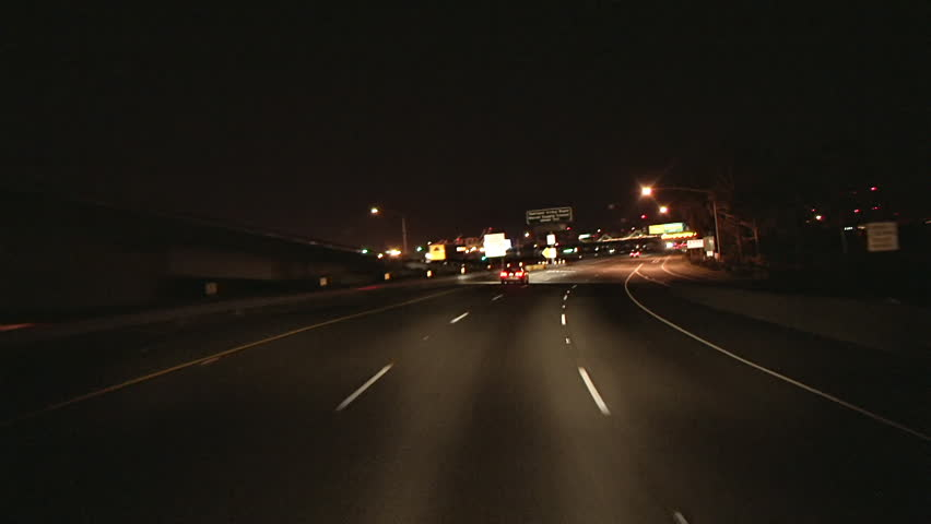 Nighttime POV driving shot of Interstate 80, heading toward the Oakland-S.F. Bay