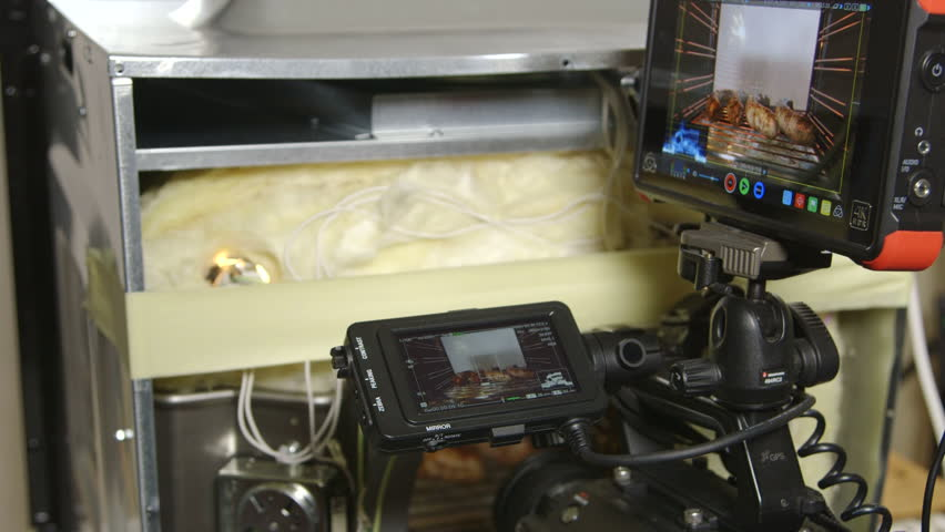 MOSCOW, RUSSIA - CIRCA AUGUST 2017: Behind the scenes, video recording studio setup food preparation inside electric oven. Sony PXW-FS7 XDCAM Super 35 camera and Atomos Ninja Flame HDMI monitor | Shutterstock HD Video #31028209