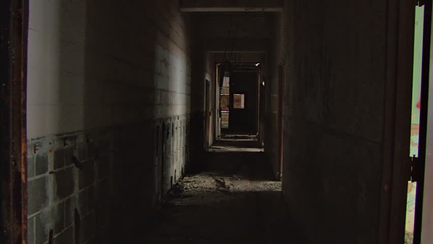 A dark hallway of nasty ruin and decay in a wretched, decrepit abandoned