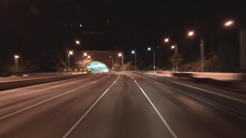Driving POV freeway time lapse through Yerba Buena tunnel heading toward San