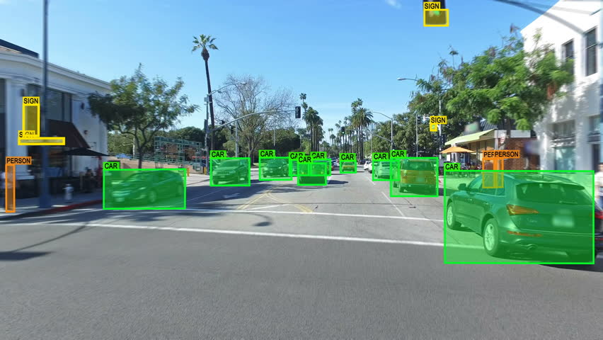 Autonomous car driving through Los Angeles. Computer vision. Object detection system that creates boxes to recognize objects in the streets. Artificial intelligence technology.  | Shutterstock Video #31202209