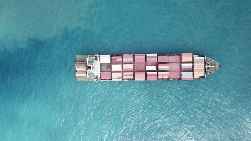 A container ship is entering the port loaded with containers and cargo - aerial 4k view | Shutterstock HD Video #31205086