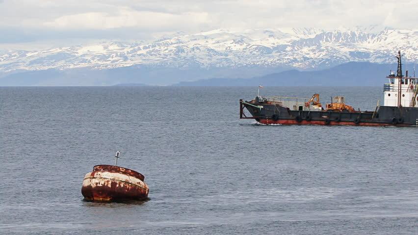 HOMER, AK - CIRCA 2012: Large industrial landing craft leaving Homer Harbor