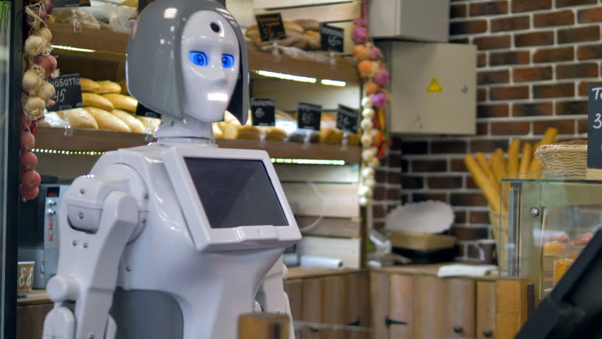A white robot works at a bakery counter.  | Shutterstock HD Video #31375276