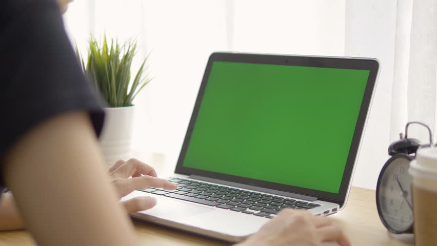 Woman working at home on with laptop green screen | Shutterstock HD Video #31458289