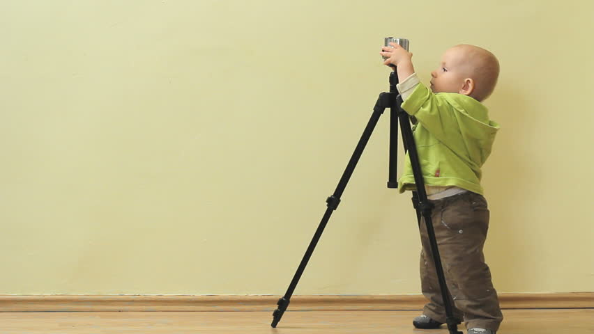Image result for baby holding camera