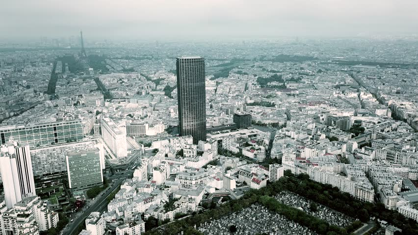 Aerial panoramic shot of Paris cityscape and the Eiffel tower as seen from Montparnasse area on a cloudy day, France | Shutterstock Video #31715143