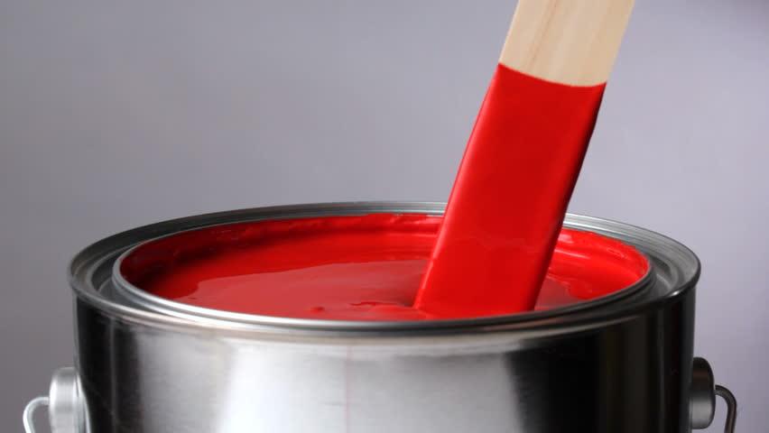 Stirring red paint