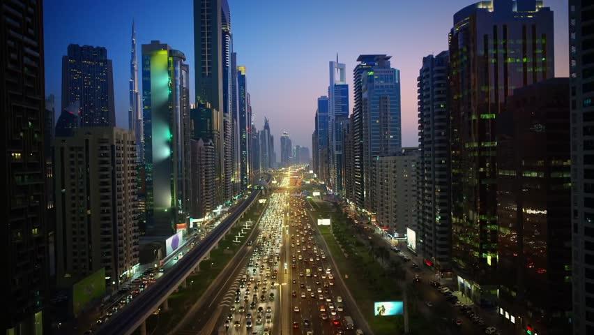 Huge futuristic skyscraper building of Dubai big city lights warm pink evening sunset in impressive aerial drone view | Shutterstock Video #31789150