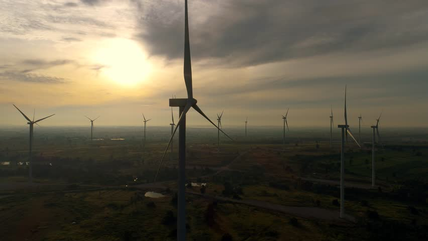 Wind turbines farm - Energy Production with clean and Renewable Energy - 4k  aerial shot on sunset. 4k drone footage of wind farm turbines at sunrise with clouds | Shutterstock HD Video #31928743