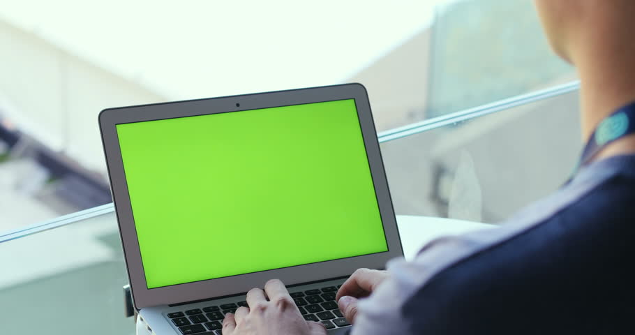 Man working laptop sitting notebook green screen chromakey mock up reading book net thinking waiting download programmer software engineer IT tech trendy lifestyle male closeup designer working app 3g | Shutterstock HD Video #32012866