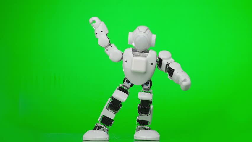 Humanoid robot dances a popular style dance. Green screen.
