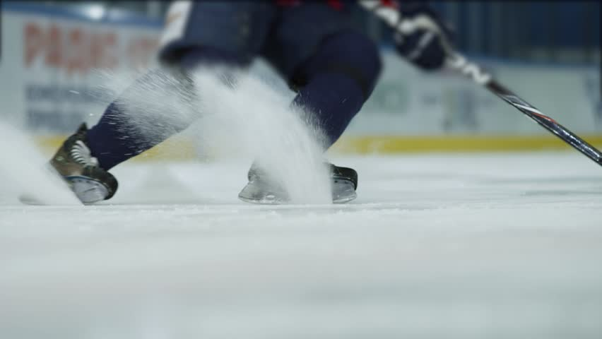 Ice hockey. Close-up of hockey skates. The hockey player does the braking on the ice.   Shutterstock Video #32052640