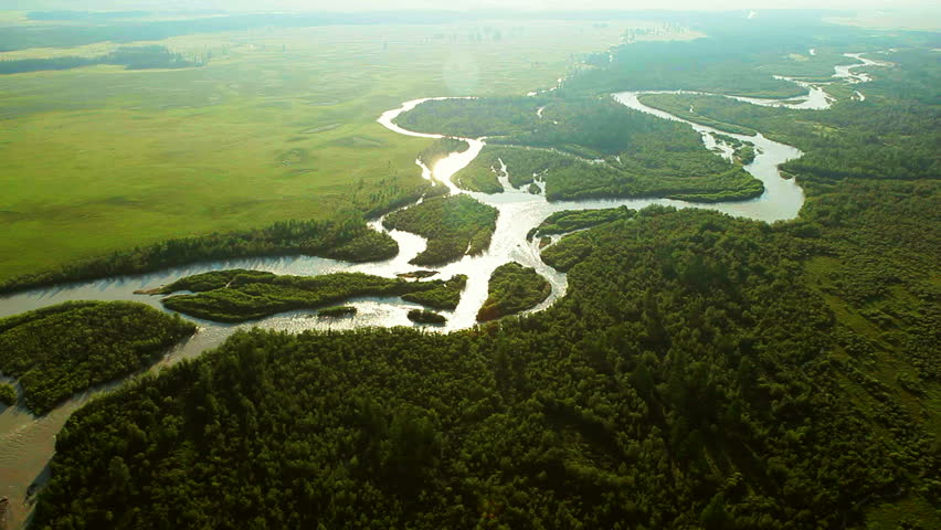 Aerial View. Flying over the beautiful mountain River. Aerial camera shot. Landscape panorama. Altai, Siberia.