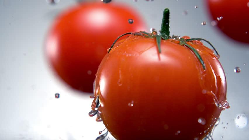 Water splash on tomato shooting with high speed camera, phantom flex. | Shutterstock Video #3230119