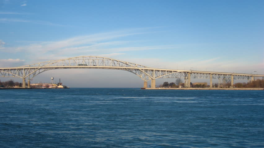 Bridge and Freighter Timelapse. Time-lapse view is looking north towards Lake