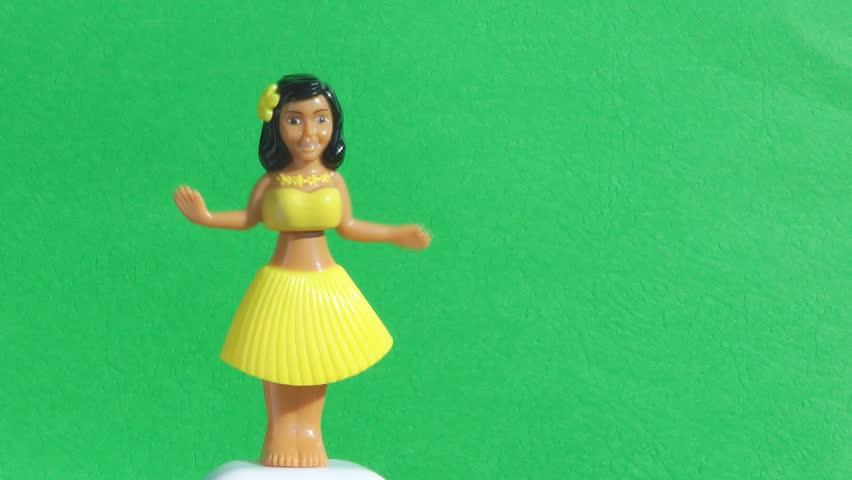 Traditional Plastic Toy Hawaiian Hula Girl Dancing Against A Green Screen