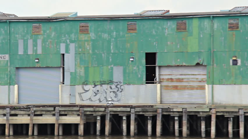Mississippi Riverside 1 New Orleans Dock. Dock and warehouse along the banks of
