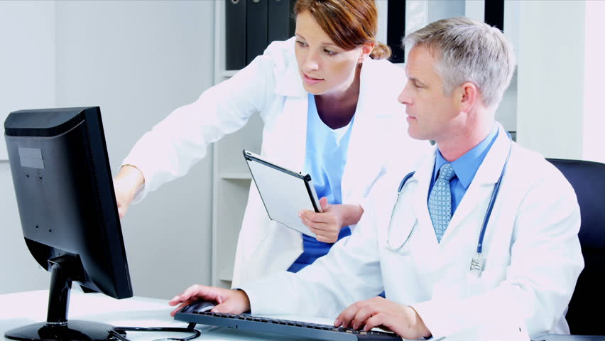 Caucasian Male Medical Consultant With Young Female Doctor ...