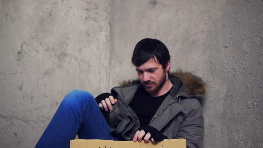 homeless sitting on the floor