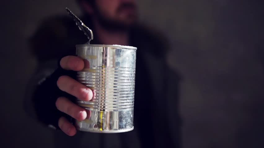 homeless man hold out a tin