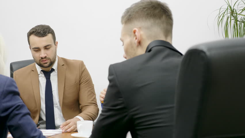 Team of business partners presenting their new projects to potential investors in their office | Shutterstock HD Video #33134104