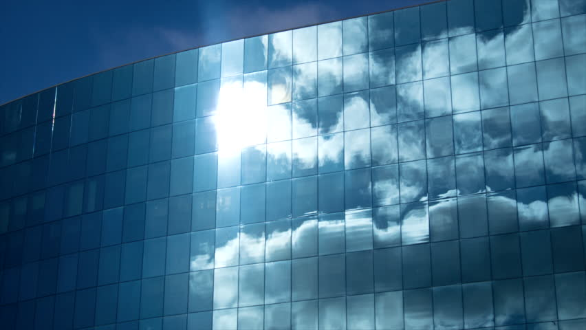 Clouds refelected in modern office building. Apple ProRes.