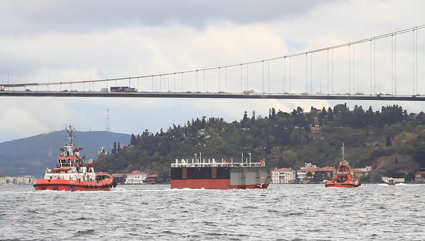 Pilotage service boats towing a large platform into the Black Sea
