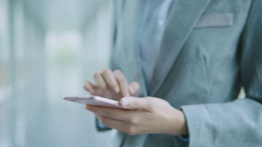 Businesswoman touching on cellphone at street | Shutterstock HD Video #33440614