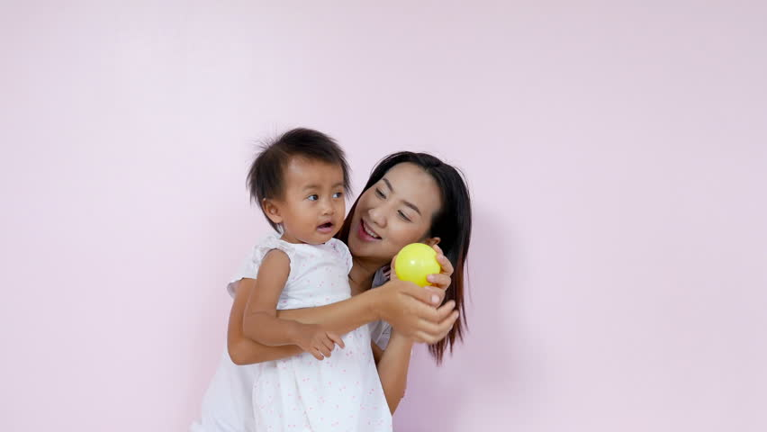 4k of Asian mom and her baby having fun and playing at home   Shutterstock HD Video #33606706